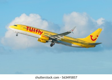 DUSSELDORF / GERMANY - NOVEMBER 2015 TUIfly Boeing 737-8K5(WL), D-ATUI, cn 34690 / 2184 climbing away from runway 23L into the afternoon sun.