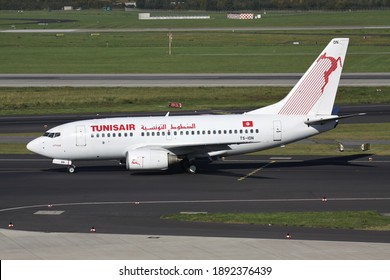 DUSSELDORF, GERMANY - OCTOBER 1, 2011: Tunisair Boeing 737-600 with registration TS-ION on taxiway at Dusseldorf Airport.