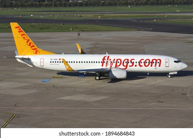 DUSSELDORF, GERMANY - OCTOBER 15, 2011: Turkish Pegasus Boeing 737-800 with registration TC-AAI on taxiway at Dusseldorf Airport.