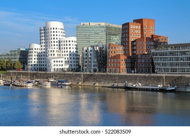 DUSSELDORF, GERMANY - OCTOBER 2, 2013: The buldings of Neuer Zollhof in Media Harbor. The buldings was designed by the world famous American architect Frank O. Gehry and completed in 1998.