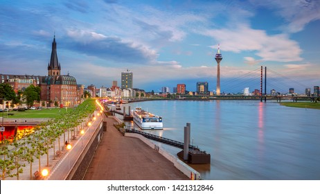 Dusseldorf, Germany. Panoramic cityscape image of riverside Düsseldorf, Germany with Rhine river during sunset.