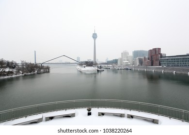 Dusseldorf media harbor district winter panorama with snow overlooking the river Rhine