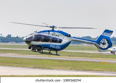 dusseldorf, nrw/germany - 12 05 18: german police helicopter in the air at dusseldorf airport germany