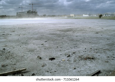 Dust blowing across site of former chemical works, UK