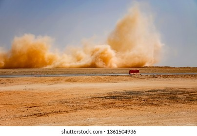 Dust clouds after the blast in the desert of Oman