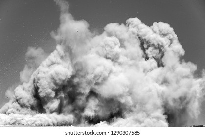 Dust clouds after the detonator blat on the mining site