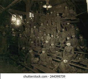 Dust covered Breaker Boys during a noon hour break at a South Pittston Pennsylvania Coal mine. The youngest coal mine workers started at this unskilled work. January 1911 photo by Lewis Hine.
