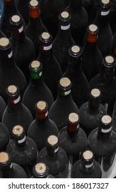 Dust on old wine bottles in a cellar vault