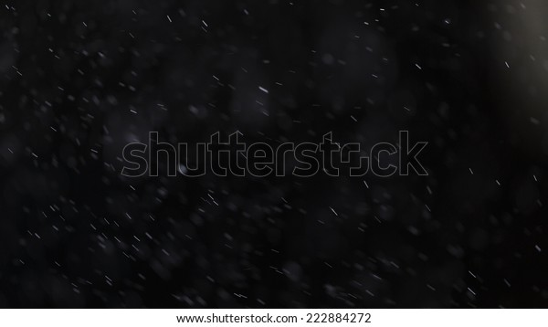 dust particles falling on black background, macro