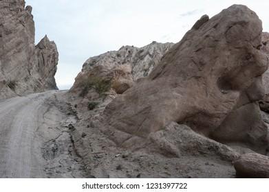 The dust road of Quebrada de las Flechas in the Salta region on Argentina