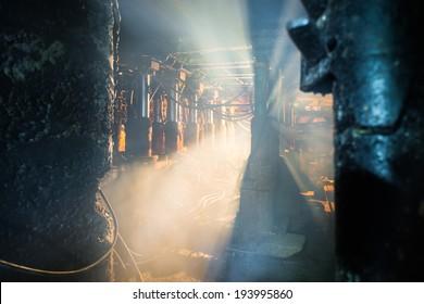dust and smoke in coal mine, hydraulic machinery