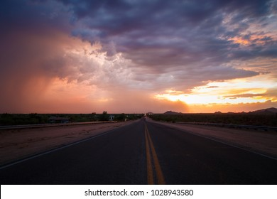 Dust storm/haboob covering the sky during sunset. Stormy landscape with long road. Road trip. Scenic stormy landscape.