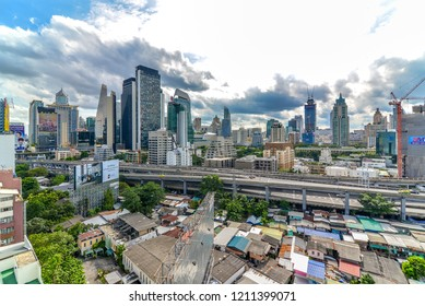 Dust,Air pollution,Grey cloud,Crowded cityscape,traffic on express way, nana town, constructions of high tower,condo, office building in business area sukhumvit rd, Bangkok,Thailand-October 24, 2018