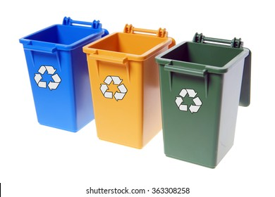 Dustbins in the colors blue, yellow and green isolated over a white background / Dustbins