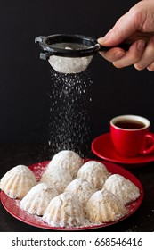 Dusting Egyptian Eid Cookies with Icing Sugar, Vertical