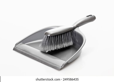 Dustpan and hand brush on white background