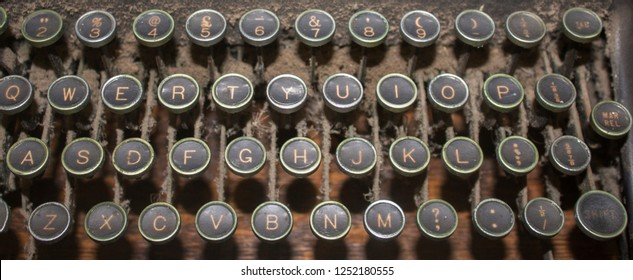 A dusty antique QWERTY typewriter keyboard