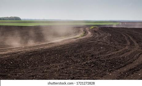 Dusty dirt road in the field.