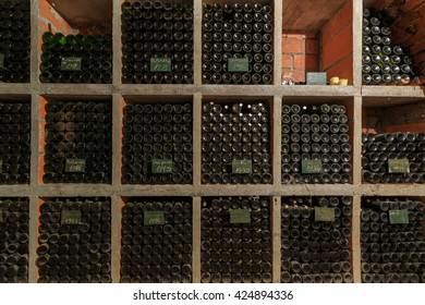 Dusty old bottles stacked in the wine cellar