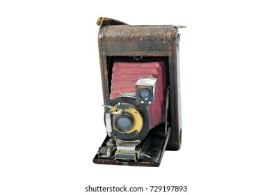 A dusty, old film camera from 1905 made of metal and leather.