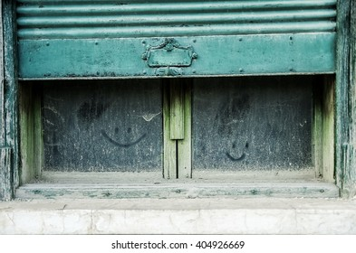 dusty old windows with smiley faces