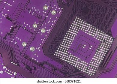 Dusty printed circuit board. High tech closeup. Printed circuit board with paths for micro assembly.