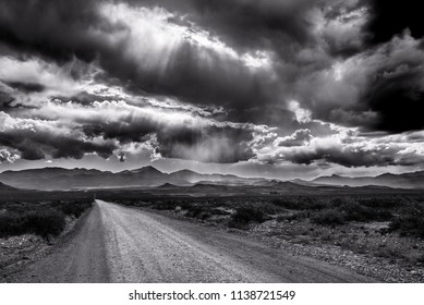 Dusty road and rays of sun through the cluds. taken in Mendoza Province, Argentina