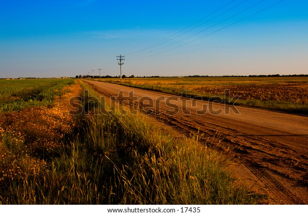 A dusty road through the countryside.