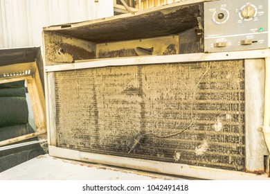 dusty and rusty coil of a window air conditioner and need cleaning service