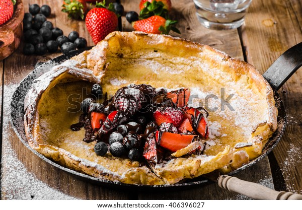 Dutch Baby Pancakes with berries and chocolate, baked in oven on iron pan, best pancakes ever!!!