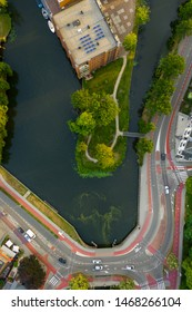 Dutch Biking lanes seen from above. Aerial view with a drone of typical dutch infrastructure, including bicycle lanes along the normal car roads. City of Woerden.