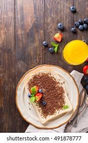 Dutch breakfast, slice of bread with hagelslag chocolate sprinkles and berries. Top view. Copy space.