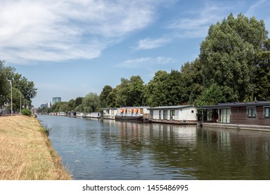 Dutch canal in city Utrecht with several moored houseboats