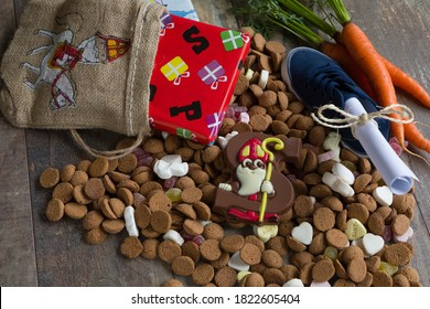 Dutch candy called Pepernoten eaten during Sinterklaas feast. Beside it presents for the kid and the shoe of the kid with carrots and a drawing