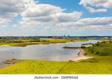 The Dutch city of Arnhem in Gelderland with the Nederrijn in front