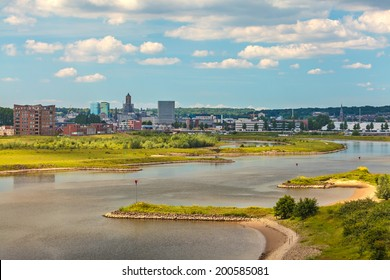 The Dutch city of Arnhem in Gelderland with the Nederrijn in front