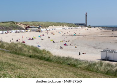 Dutch coast near Westkapelle with seaside visitors relaxing at the beach