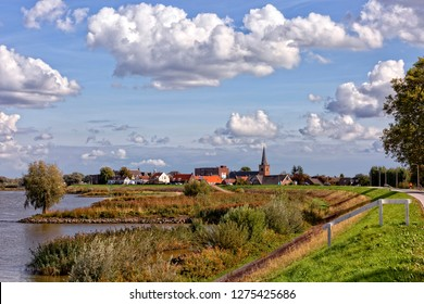 Dutch country view  Looking to the Dutch polders and dykes in South Holland in the neighborhood of the Dutch windmills of the Kinderdijk. You can real enjoy of this part of the Netherlands. Enjoy