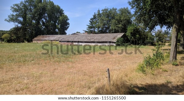 Dutch countryside, old barn with asbestos roof. In Holland it will be prohibited by law to have any roofs with traces of asbestos in them by 2024.