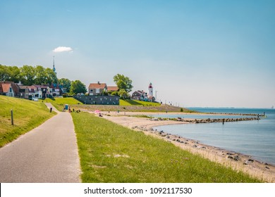 Dutch dike with lighthouse and village Urk Flevoland Netherlands