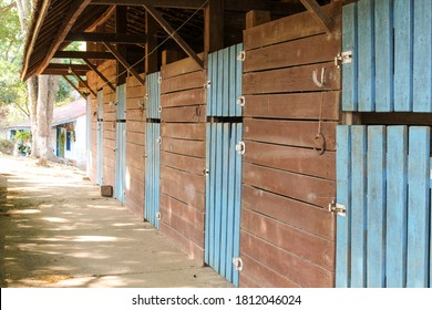 Dutch door to Colonial-style  horse stable, with door close