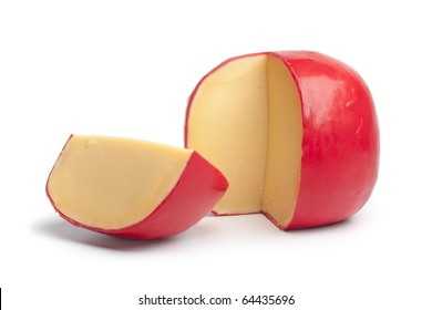 Dutch Edam cheese with a quarter on white background