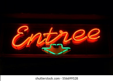 Dutch 'Entrance' red neon sign ('Entree' in Dutch means 'Entrance') with a green neon arrow