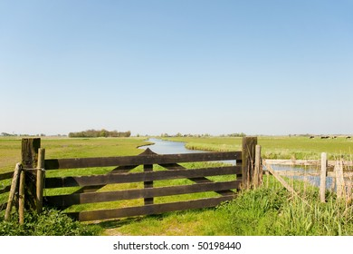 Dutch farmland with fence in the meadows