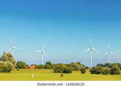 Dutch farmland with four windmills in Gelderland near Arnhem, The Netherlands