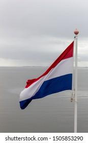 Dutch flag with the ijselmeer