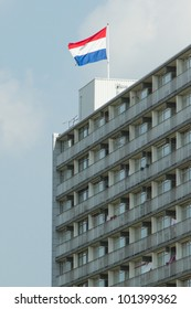 Dutch flag on top of a block of flats against the blue sky on Queen's Day. Leeuwarden,Friesland,Holland
