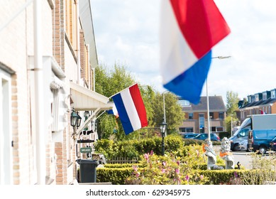 Dutch flags in a street during Kingsday in The Netherlands