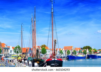 Dutch flat bottom boats, sailing boats in a harbor, in Holland Ziereksee. Province of Zeeland, The Netherlands.