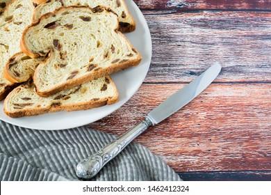 Dutch fruit bread with raisins on white plate